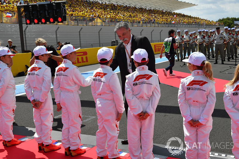 Chase Carey, Chief Executive Officer and Executive Chairman of the Formula One Group and grid kids