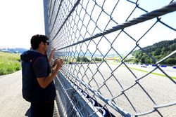 Mark Webber watches as Marc Marquez tests the Toro Rosso F1 car
