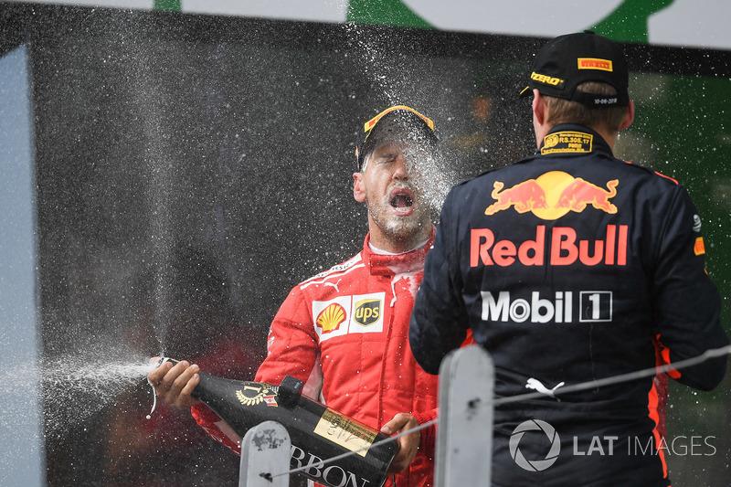 Race winner Sebastian Vettel, Ferrari and Max Verstappen, Red Bull Racing celebrate on the podium wi