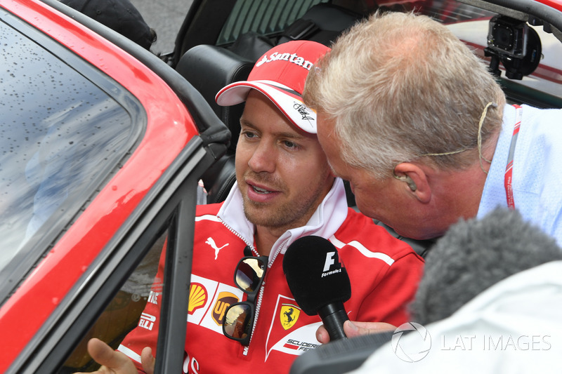 Sebastian Vettel, Ferrari talks to Johnny Herbert, Sky TV on the drivers parade