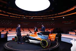 Yusuke Hasegawa, Senior Managing Officer, Honda, Eric Boullier, Racing Director, McLaren, and presenter Simon Lazenbyon stage at the launch of the McLaren MCL32