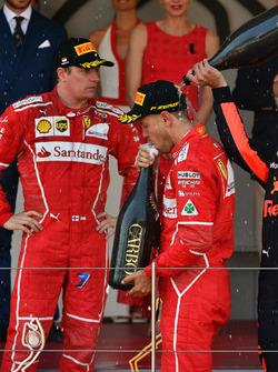 Sebastian Vettel, Ferrari and Kimi Raikkonen, Ferrari celebrate on the podium with the champagne