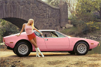 Playboy Playmate of the Year 1972 Liv Lindeland and her pink De Tomaso Pantera