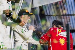 Lewis Hamilton, Mercedes AMG, 2nd Position, Valtteri Bottas, Mercedes AMG, 3rd Position, and Sebastian Vettel, Ferrari, 1st Position, spray Champagne on the podium