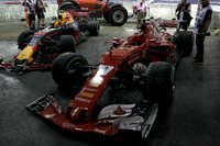 The damaged cars of Max Verstappen, Red Bull Racing RB13 and Kimi Raikkonen, Ferrari SF70H after crashing out at the start of the race