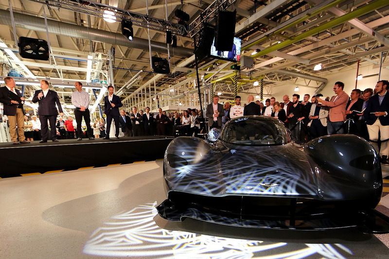 Andy Palmer- President & Chief Executive Officer, Aston Martin Lagonda Ltd talks on stage with Martin Brundle, David King- Vice President & Chief Special Operations Officer, Aston Martin Lagonda Ltd and Red Bull Racing Team Principal Christian Horner. Marek Reichman- Executive Vice President & Chief Creative Officer, Aston Martin Lagonda Ltd, Daniel Ricciardo of Australia and Red Bull Racing and Adrian Newey, the Chief Technical Officer of Red Bull Racing behind the car at the Aston Martin and Red Bull Racing Project AMRB 001 Unveil