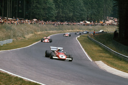 Jacky Ickx, Ferrari 312B2, leads Ronnie Peterson, March 721G Ford; Clay Regazzoni, Ferrari 312B2; Emerson Fittipaldi, Lotus