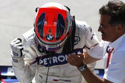 1. Robert Kubica, BMW Sauber F1.08, mit Mario Theissen, BMW-Motorsportdirektor