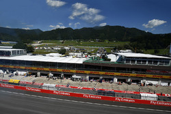 A scenic view of the pit straight and garages