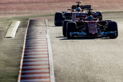 Kimi Raikkonen, Ferrari SF70H, leads Fernando Alonso, McLaren MCL32