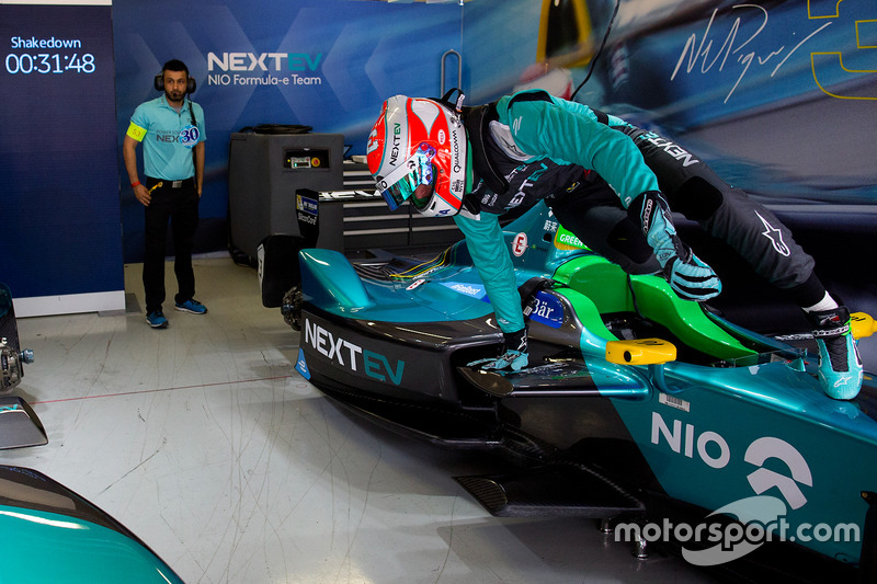 Nelson Piquet Jr., NEXTEV TCR Formula E Team, jumps from his car in the garage