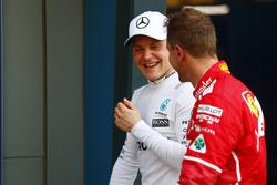 Valtteri Bottas, Mercedes AMG, with Sebastian Vettel, Ferrari