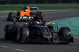 Romain Grosjean, Haas F1 Team VF-19, leads Carlos Sainz Jr., McLaren MCL34