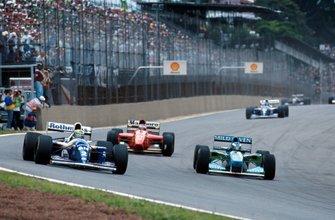 Michael Schumacher, Benetton B194 and Ayrton Senna, Williams FW16