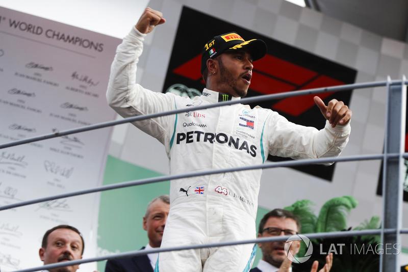 Winner Lewis Hamilton, Mercedes AMG F1, celebrates on the podium