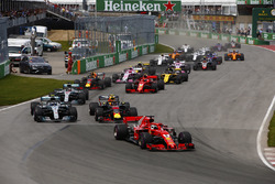 Sebastian Vettel, Ferrari SF71H leads Max Verstappen, Red Bull Racing RB14, Max Verstappen, Red Bull Racing RB14, Lewis Hamilton, Mercedes AMG F1 W09, Kimi Raikkonen, Ferrari SF71H, Daniel Ricciardo, Red Bull Racing RB14 and the rest of the pack at the sta