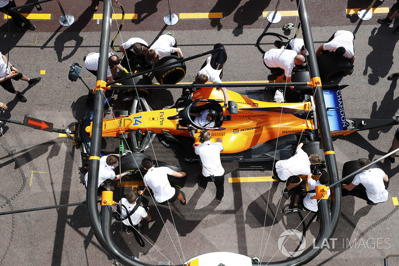 McLaren mechanics practice a pit stop on the Fernando Alonso McLaren MCL33