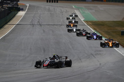 Kevin Magnussen, Haas F1 Team VF-18, leads Fernando Alonso, McLaren MCL33, Pierre Gasly, Toro Rosso STR13, and Romain Grosjean, Haas F1 Team VF-18