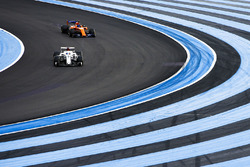Marcus Ericsson, Sauber C37, leads Fernando Alonso, McLaren MCL33