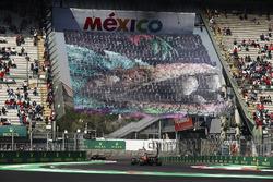 Fernando Alonso, McLaren MCL32, follows a Ferrari through the stadium section