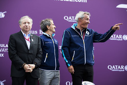 Jean Todt, Alain Prost and Jean Paul Driot on the podium