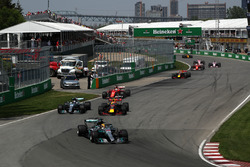 Lewis Hamilton, Mercedes-Benz F1 W08  leads as Valtteri Bottas, Mercedes-Benz F1 W08  and Max Verstappen, Red Bull Racing RB13 battle for position