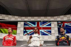 Race winner Lewis Hamilton, Mercedes AMG F1, second place Sebastian Vettel, Ferrari, third place Dan