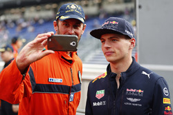 Max Verstappen, Red Bull Racing, poses for a selfie, a marshal