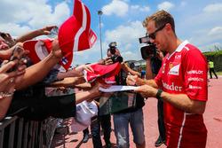 Sebastian Vettel, Ferrari sugns autographs for the fans