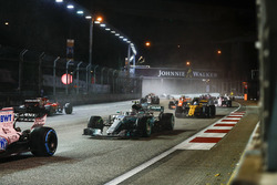 Valtteri Bottas, Mercedes AMG F1 W08, Jolyon Palmer, Renault Sport F1 Team RS17, past the stricken car of Sebastian Vettel, Ferrari SF70H