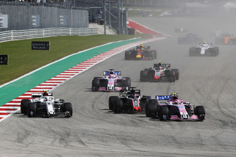 Esteban Ocon, Racing Point Force India VJM11, Charles Leclerc, Sauber C37 and Romain Grosjean, Haas F1 Team VF-18 battle