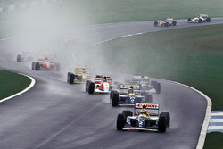 Ayrton Senna cuts through the field on the first lap, as Alain Prost leads