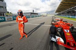 Kimi Raikkonen, Ferrari, celebrates after qualifying second