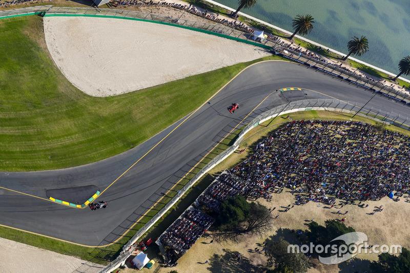 Kevin Magnussen, Haas F1 Team VF-17, leads Kimi Raikkonen, Ferrari SF70H
