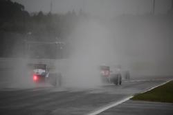 Track action under heavy rain