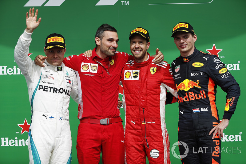 Sebastian Vettel, Ferrari, celebrates on the podium with Valtteri Bottas, Mercedes AMG F1 and Max Ve
