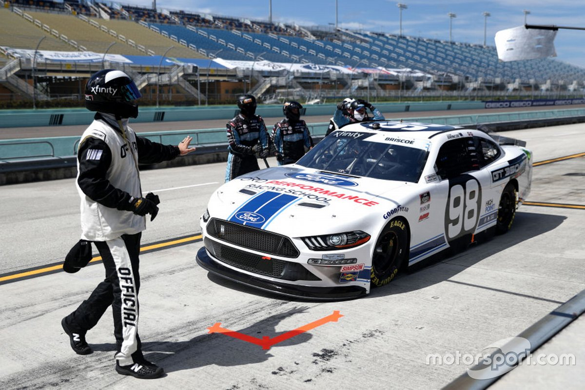 A Nascar official inspects Chase Briscoe, Stewart-Haas Racing, Ford