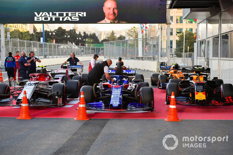 The cars of Antonio Giovinazzi, Alfa Romeo Racing C38, Daniil Kvyat, Toro Rosso STR14, Max Verstappen, Red Bull Racing RB15, Sergio Perez, Racing Point RP19, Kimi Raikkonen, Alfa Romeo Racing C38, and Lando Norris, McLaren MCL34, in Parc Ferme after Qualifying