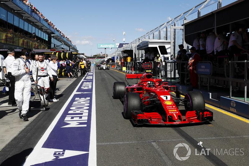 Kimi Raikkonen, Ferrari SF71H, passes the Williams team in the pit lane