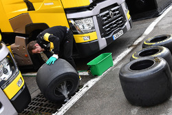 Renault Sport F1 Team mechanic washes Pirelli tyres