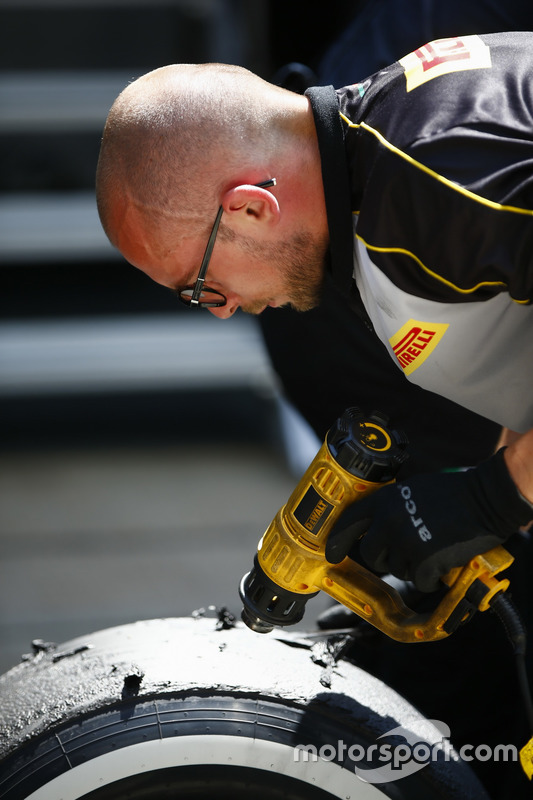 A Pirelli engineer works on some tyres