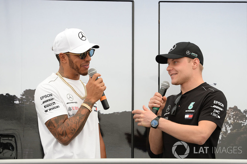 Lewis Hamilton, Mercedes-AMG F1 and Valtteri Bottas, Mercedes-AMG F1 on stage