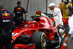 Lewis Hamilton, Mercedes AMG F1, studies the Kimi Raikkonen, Ferrari, after qualifying