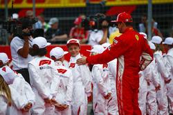 Kimi Raikkonen, Ferrari, with the grid kids