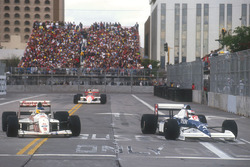 Jean Alesi Tyrrell 018 Ford laps Michele Alboreto, Arrows A11B Ford with Ayrton Senna, Mclaren MP4/5B Honda on his heels behind
