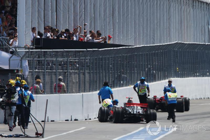 Lewis Hamilton, McLaren Mercedes MP4/23 and Kimi Raikkonen, Ferrari F2008 crash at the end of the pit lane