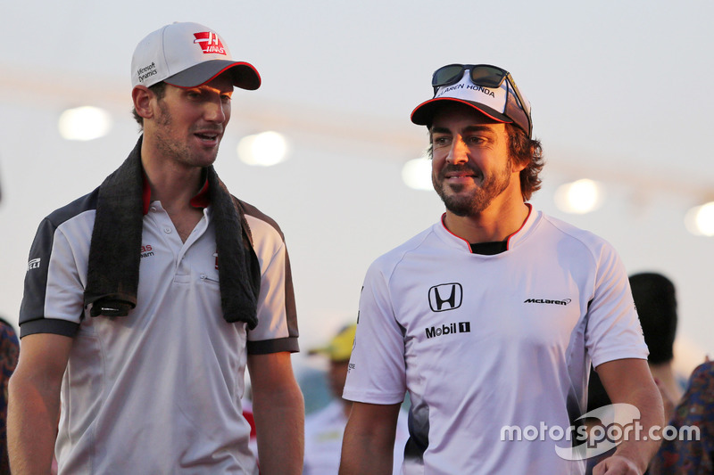 (L to R): Romain Grosjean, Haas F1 Team with Fernando Alonso, McLaren on the drivers parade
