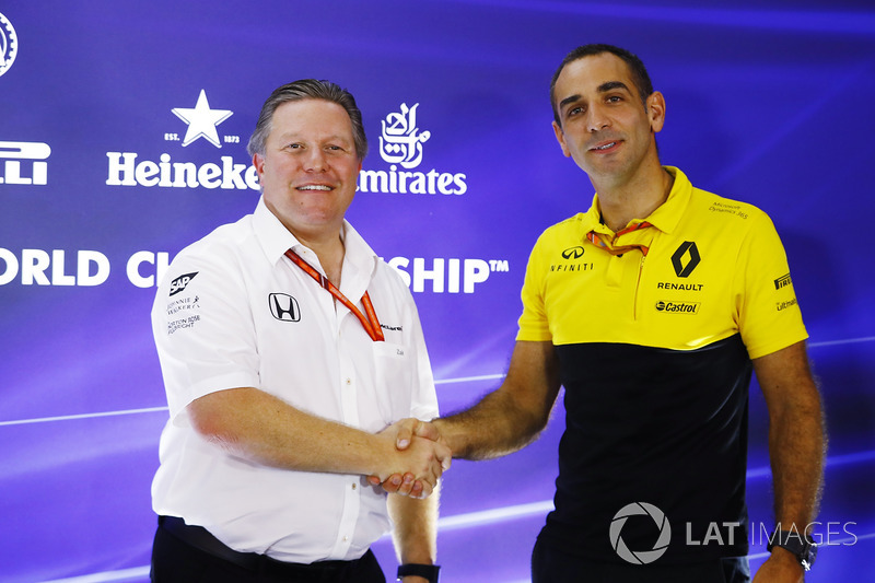 Zak Brown, Executive Director, McLaren Technology Group, shakes hands with Cyril Abiteboul, Managing Director, Renault Sport F1 Team