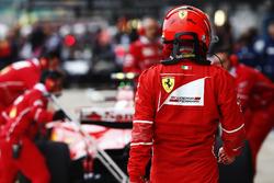 Ferrari team members work on the Kimi Raikkonen Ferrari SF70H in the pit lane