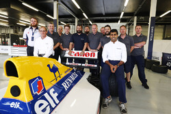 A group photo next to the Williams FW14B Renault